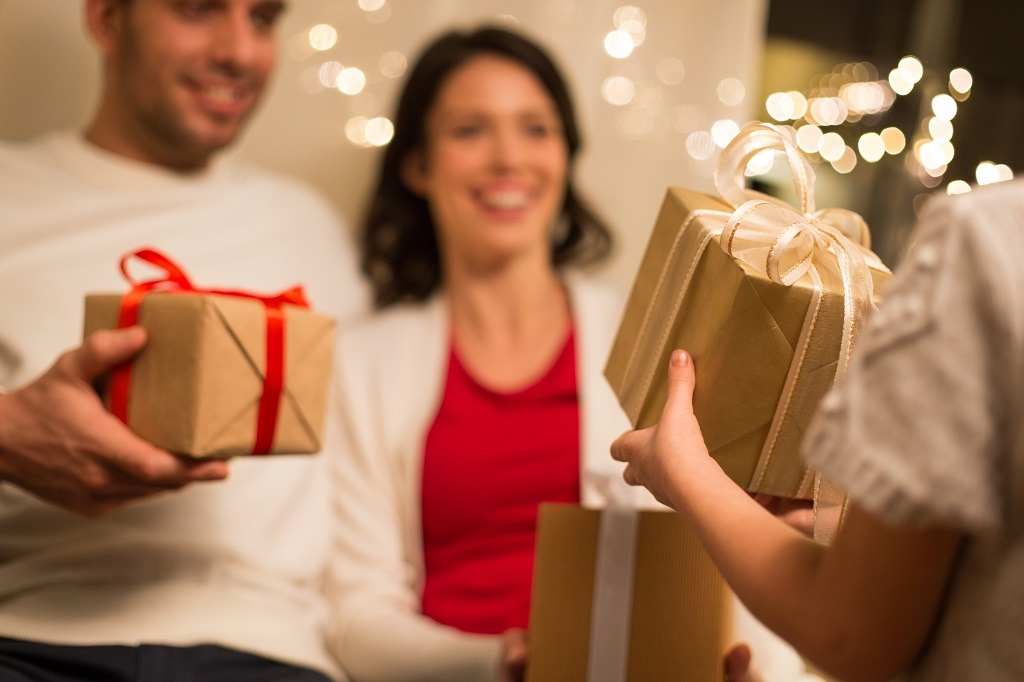 Family exchanging christmas gifts at home.