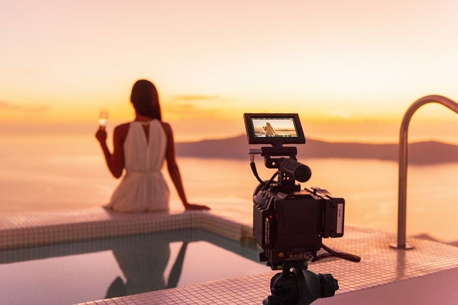Behind the scenes shoot of an actress filming a movie on a luxury hotel location.