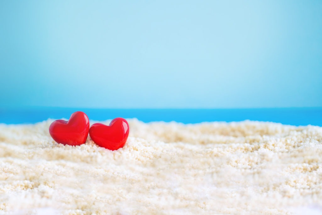 Red Heart shape on white sand beach ,Image For Love Valentine Day or summer vacation Concept.