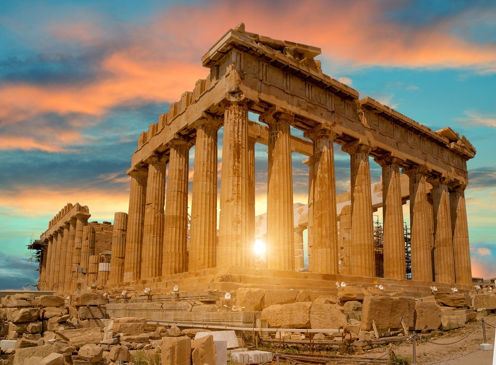 Parthenon Athens Greece sun beams and sunset colors.