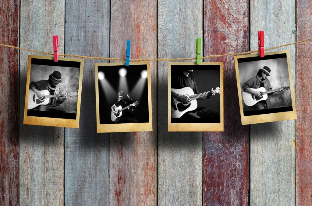Photos of a guitarist hanging on a clothesline on wood background.