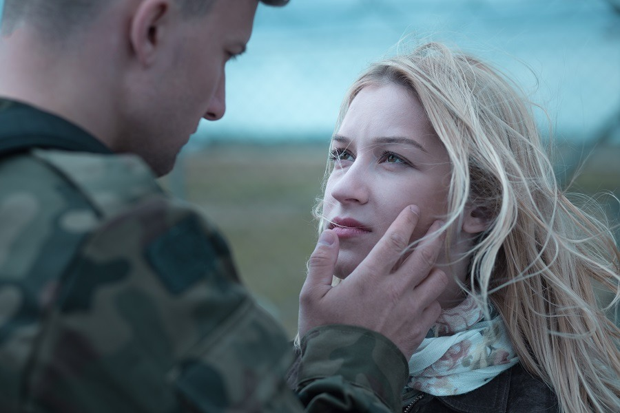 Soldier saying goodbye to her lover.