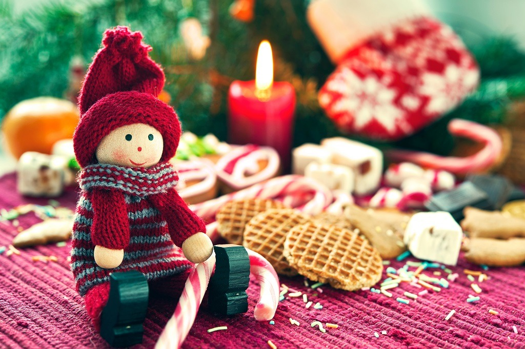 Christmas wooden doll with sweets.