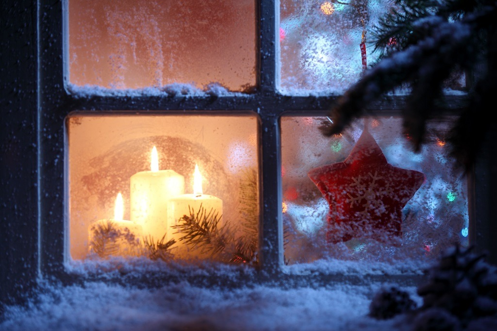 Frosted window with Christmas decoration.