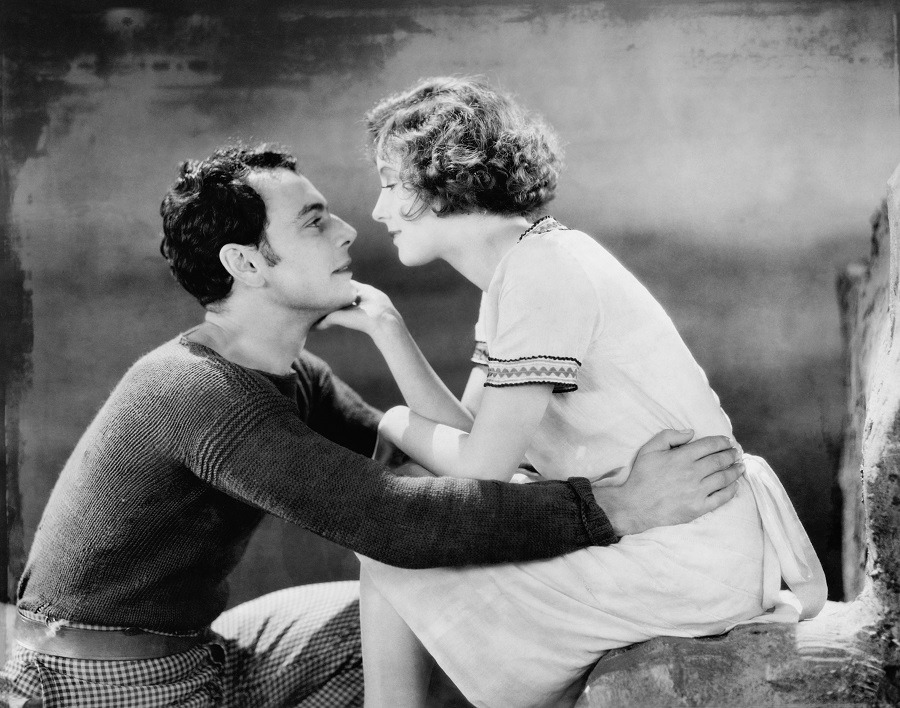 Vintage couple in love, looking at each other passionately.