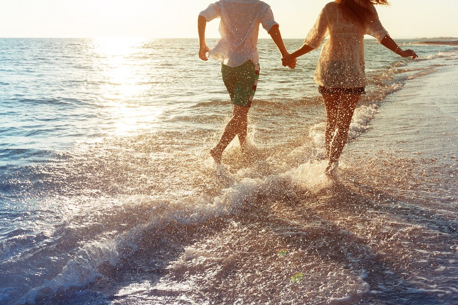 Happy young couple enjoying in the sea.