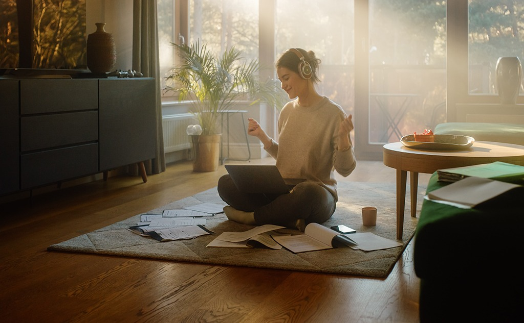 Woman using laptop and listening to music