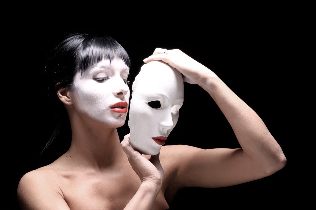 Theater actress with a mask.