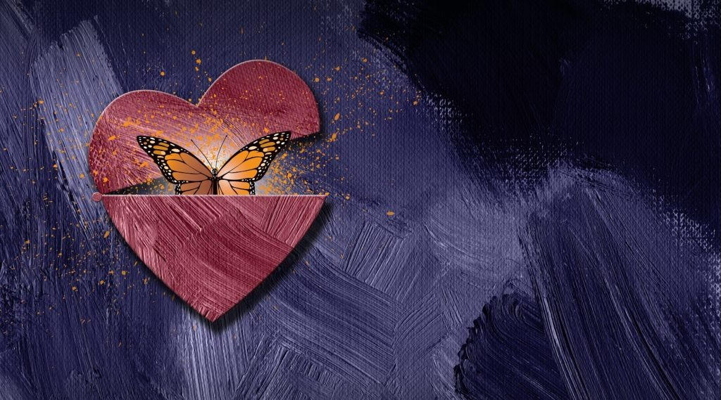 Graphic abstract butterfly escapes an opening heart.