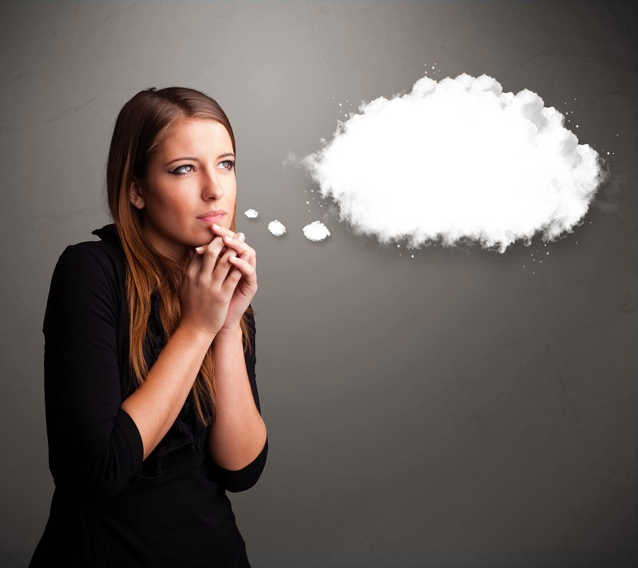 Lady thinking and envisioning, her thoughts represented by a cloud bubble.