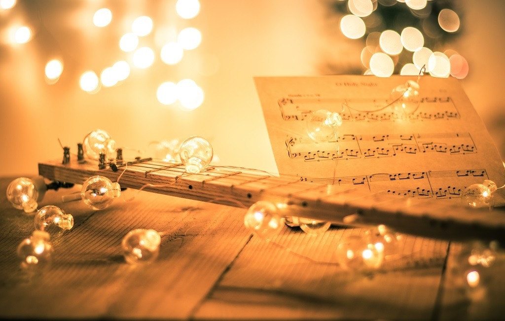 Instrumental sheet music and soft lights for Christmas holiday.