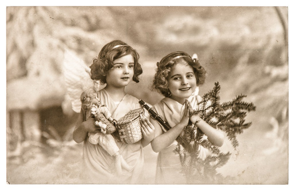 Vintage angel girls with white wings, toys and Christmas tree.