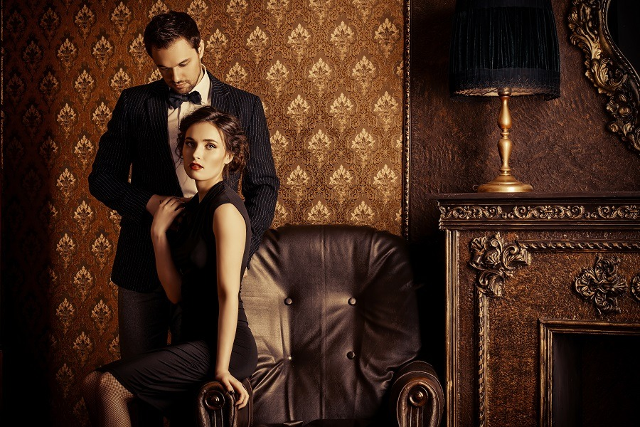 Attractive couple dressed up in black looking intimate.