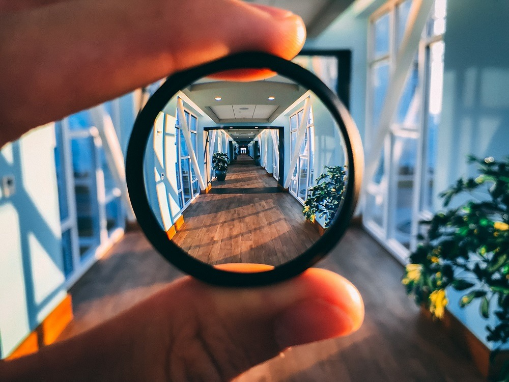 Magnifying lens giving a deep zoomed-in view of a large skybridge.