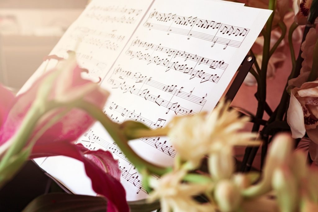 Classical sheet music in elegant floral setting.