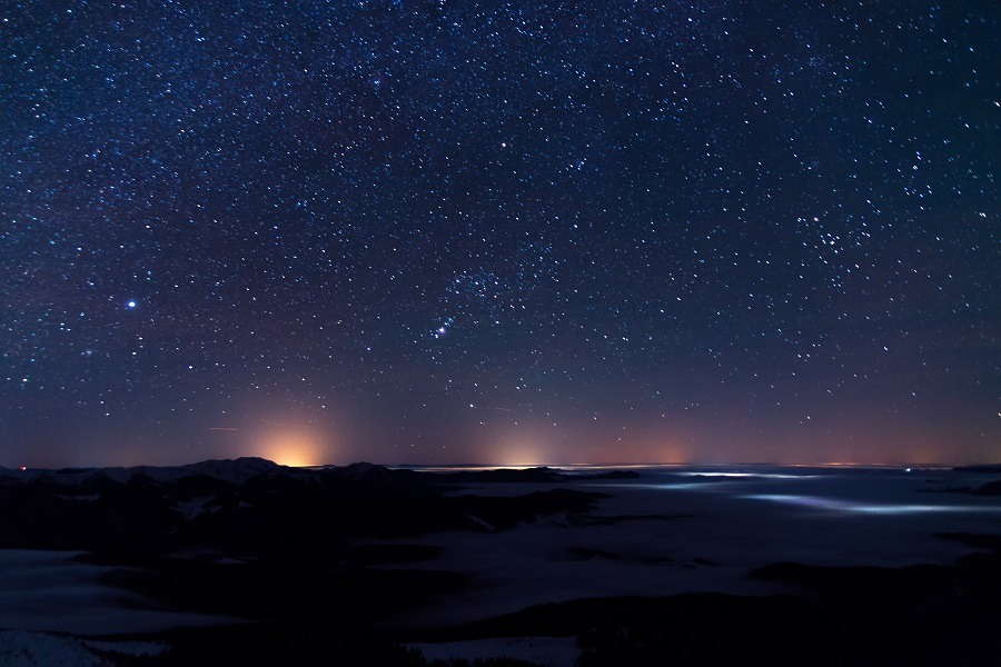 Stunning night landscape with  mountains, sky,  stars.