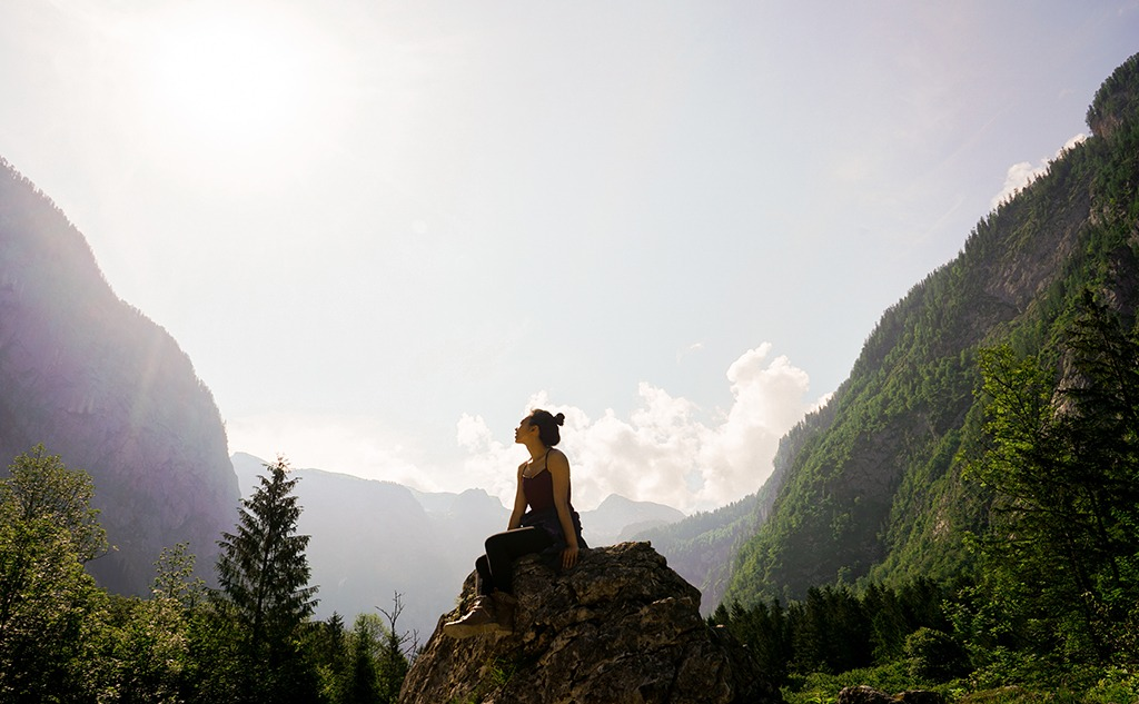 Woman on top of rock