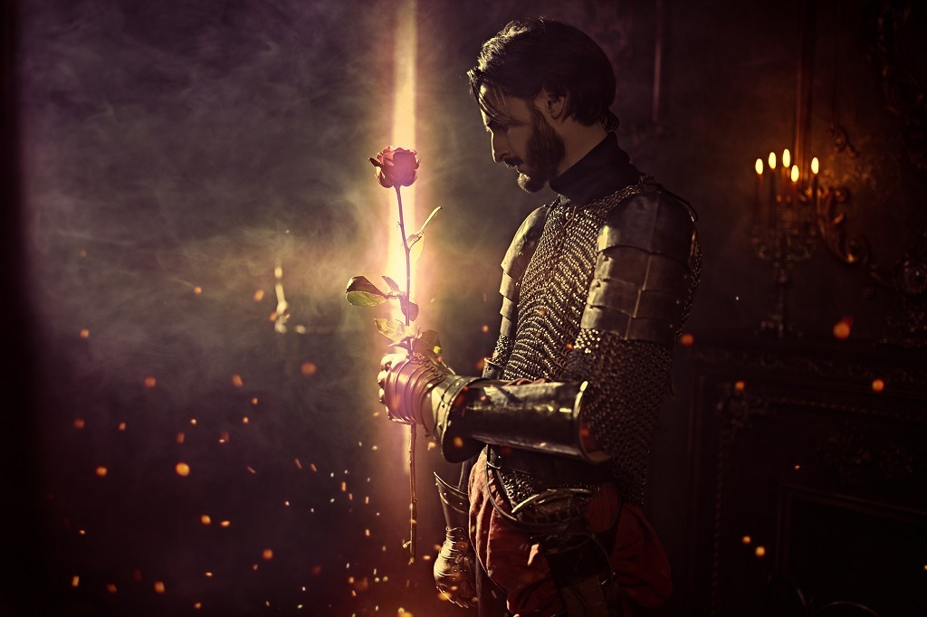 King in battle suit holding a rose in the era of romanticism.
