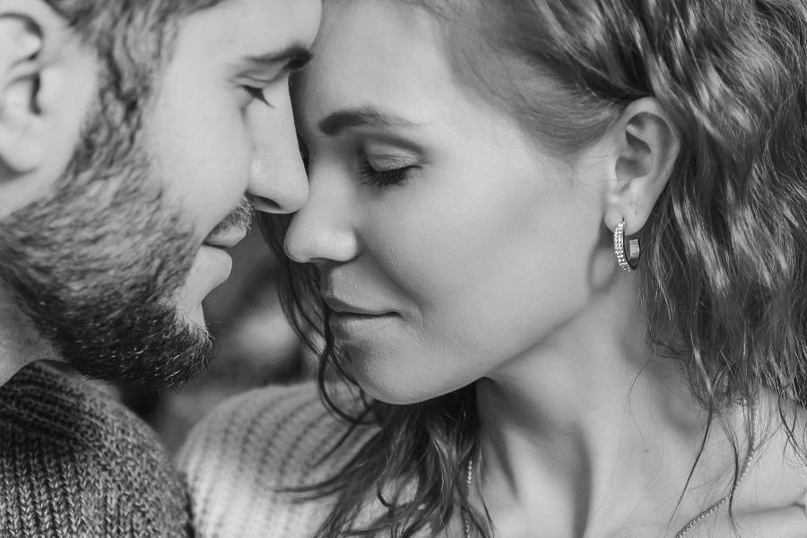 Lovely couple in love faces touch, intimate moment.