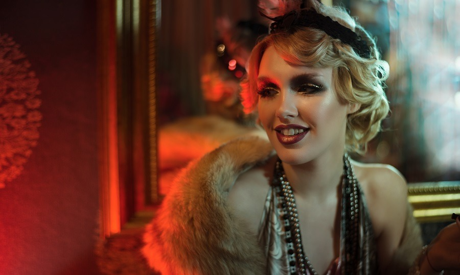 Beautiful sophisticated woman in retro style smiling at a party.