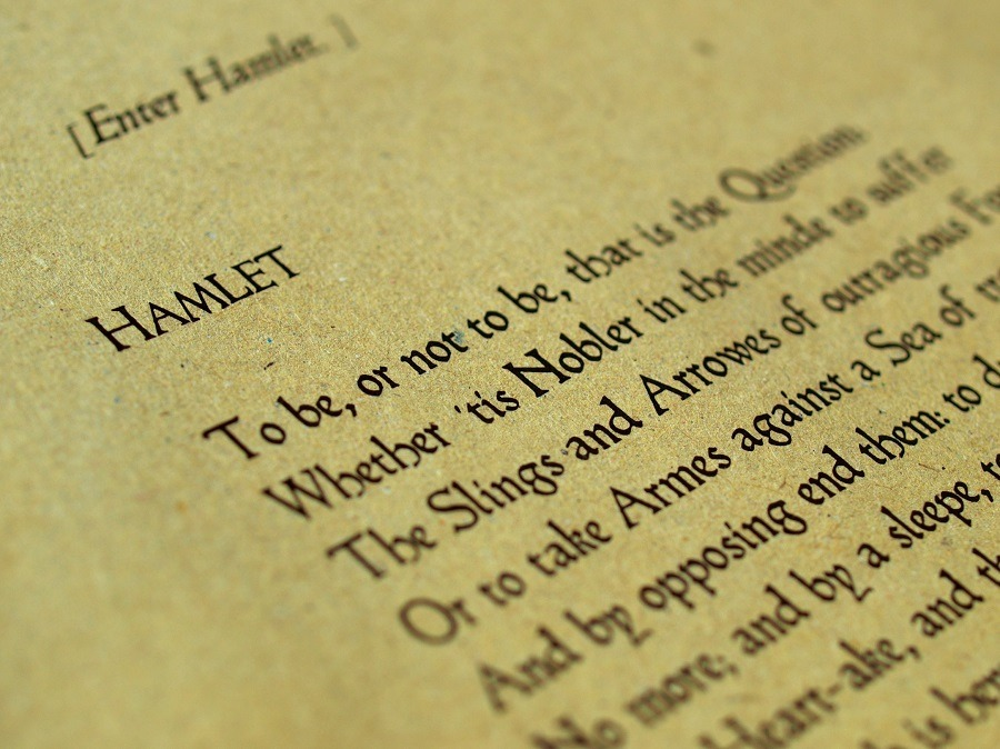 Book page containing Shakepeare's Hamlet.