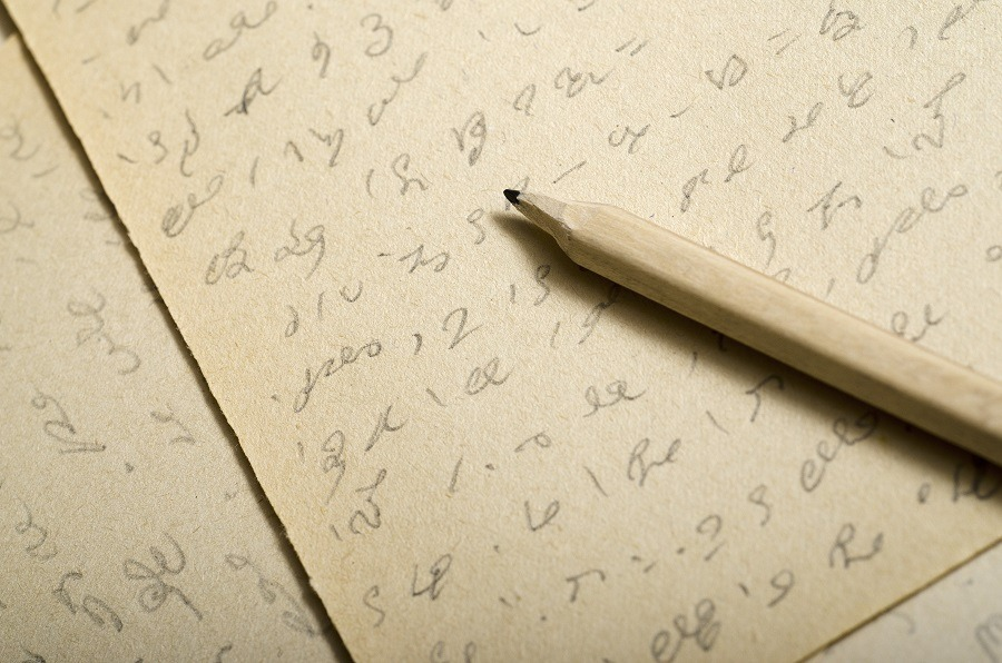 Shorthand writing on a piece of old paper.