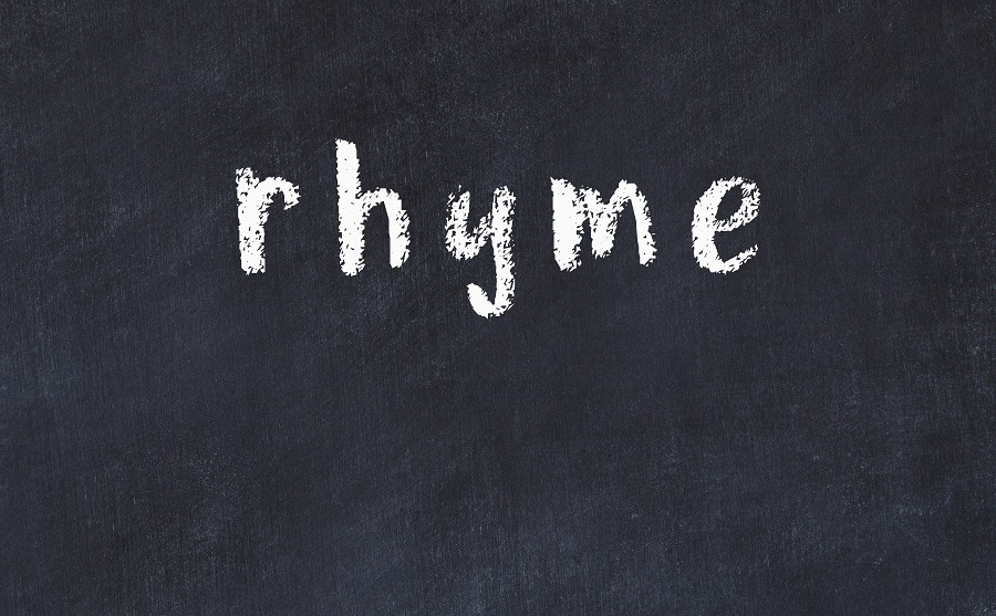 College chalk desk with the word rhyme written on it.