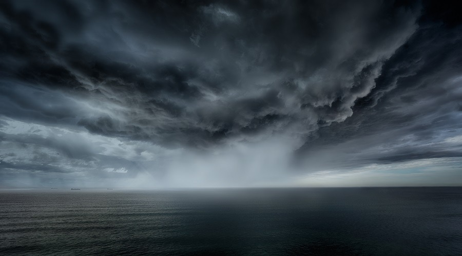 Stormy clouds and rain with dramatic sky.