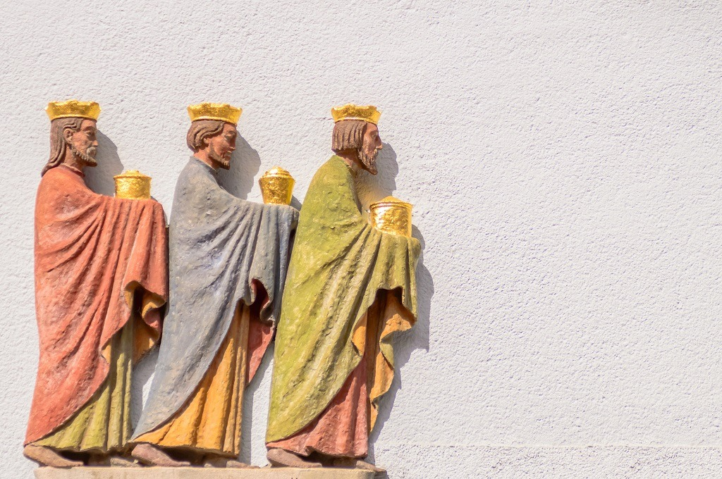 Three wise men relief on a wall.