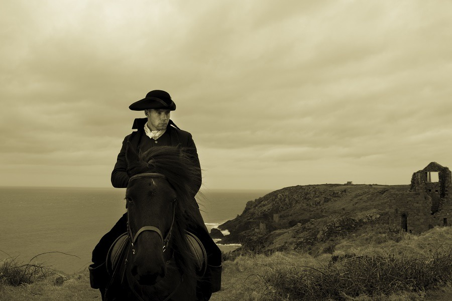 Handsome male horse rider with Atlantic ocean in background.