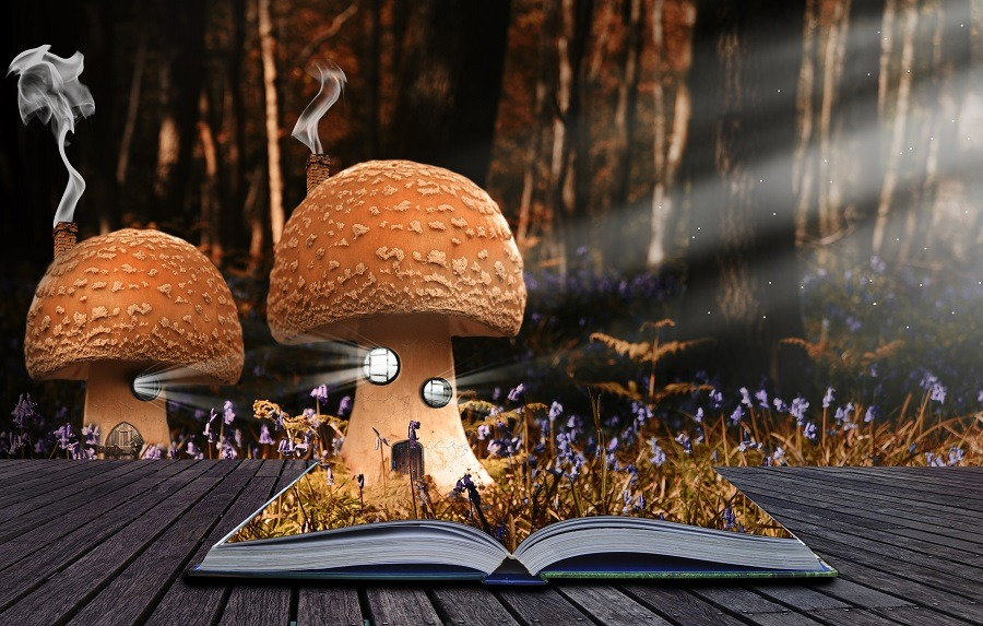 Magical book with contents spilling into landscape background.