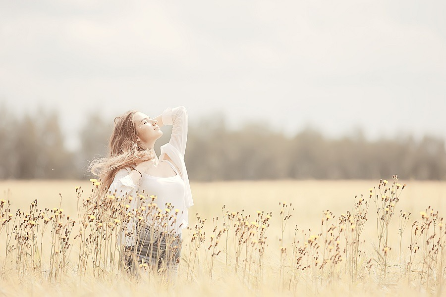 Young woman in the field enjoying the moment outdoor.