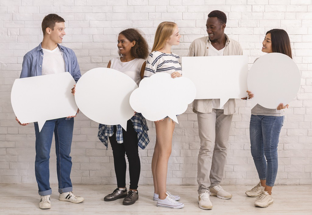 Multicultural teens with white communication bubbles having conversation.