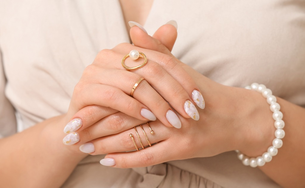 Young woman with beautiful manicure and accessories