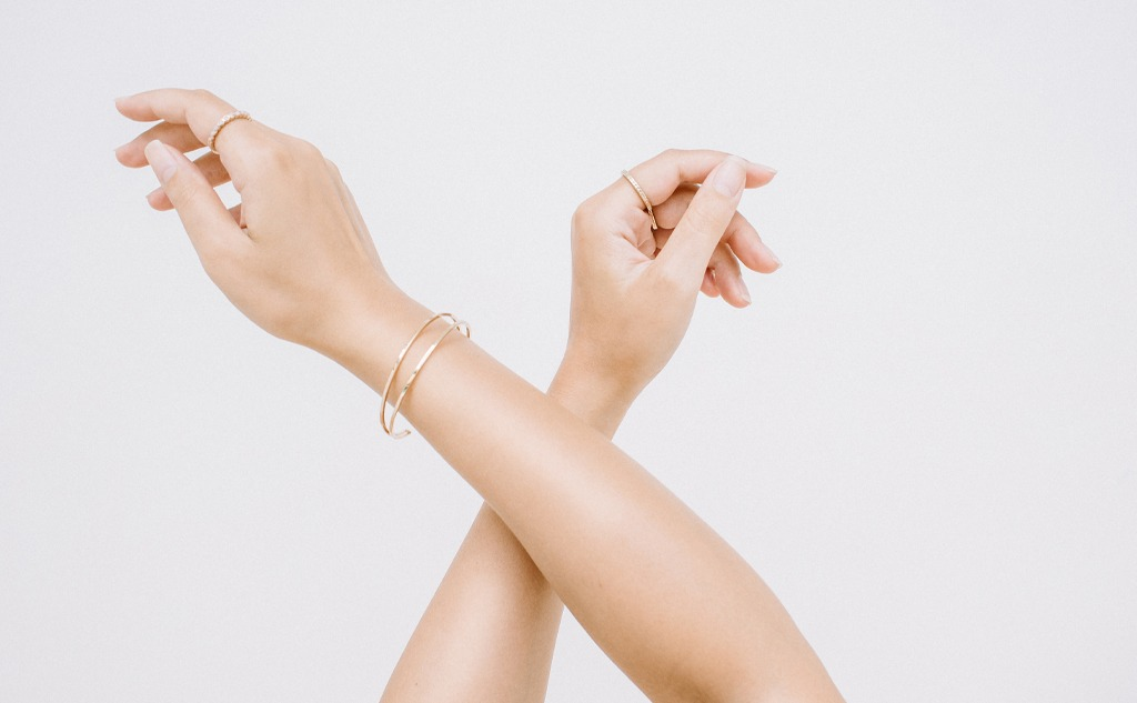 Woman hands with ring and bracelet.